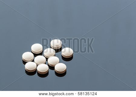 White Pills Isolated On Glass Background