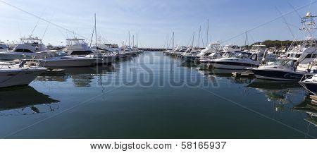 Yacht Or Motor Boat At Harbor Moored At Marina. Port  Stephens. Nelson Bay.  Australia.