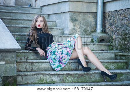 Portrait of a young woman on the streets of old european city