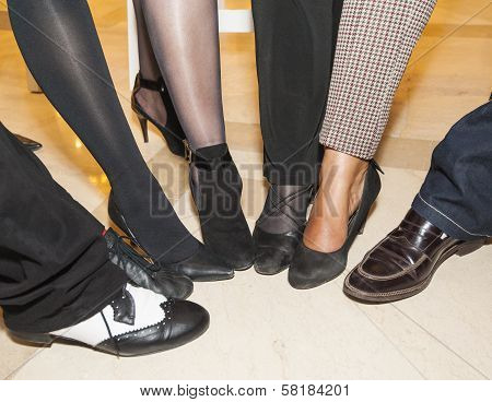 Collection Of Footwear On Peoples Feet
