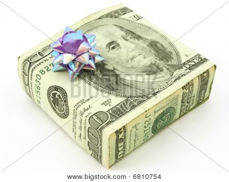 American 100 dollar bill wrapped around gift