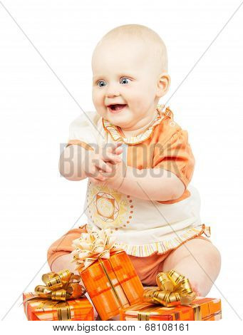 Rapt baby with festive gifts