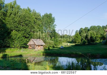 Countryside With Wooden Bathhouse And Green Nature