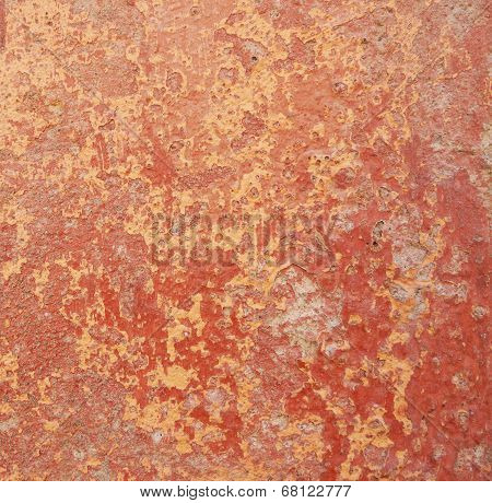 Close-up of old mottled red and pink painted wall as background