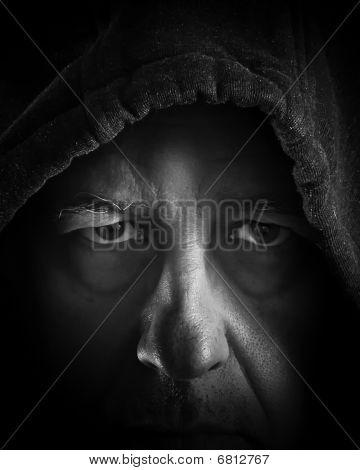 Headshot older man in shadows
