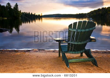 Wooden Chair At Sunset On Beach