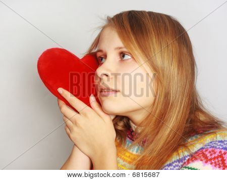 Cute girl with red fur heart