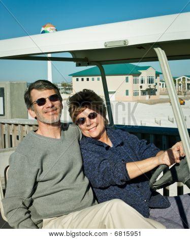 Seniors In Golfcart At The Beach