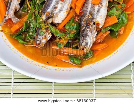 Fish Curry In White Dish On Bamboo Brown Straw