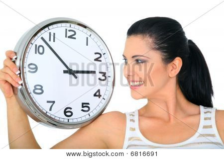 Woman Looking Over Clock