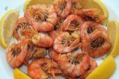 close up of fried shrimps garnished with lemon poster