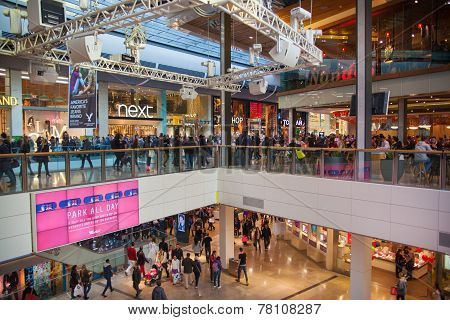 Westfield Stratford City Shopping centre with lots of people rushing for Christmas sale.