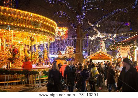 Leicester square traditional fun fair with stools, carrousel etc