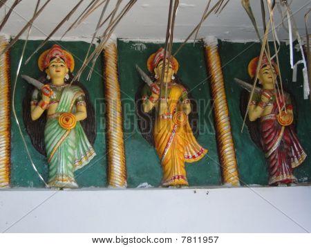 Parvati goddess statues guarding Shiva temple at Taptapani in Orissa India poster
