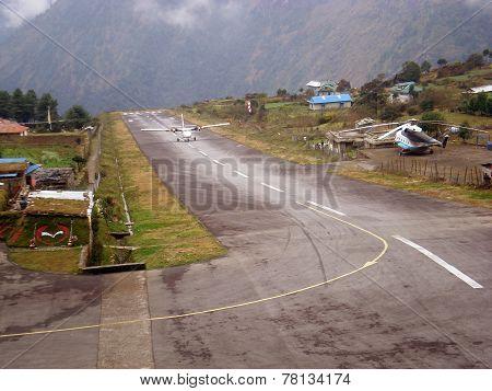 LUKLA, NEPAL - CIRCA OCTOBER 2013: plane on the runway at Lukla airport circa October 2013 in Lukla.