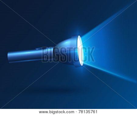Blue realistic shining flashlight in darkness