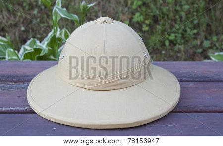 Pith helmet located on the painted bench.