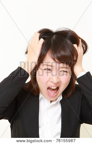 studio portrait of demented businesswoman on white background