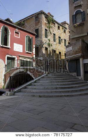 Venice bridge and ancient buildings