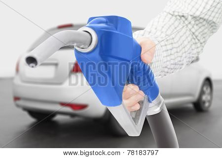Blue Color Fuel Pump Gun With Car On Background