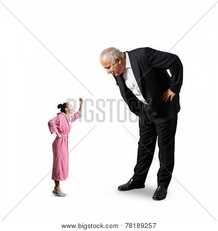 senior businessman looking down at small screaming woman in pink dressing gown. isolated on white background