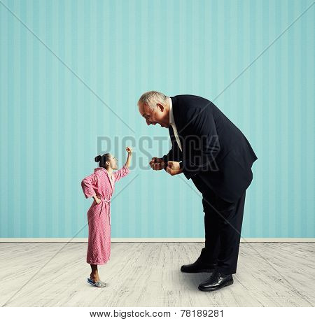 emotional senior man screaming at small woman