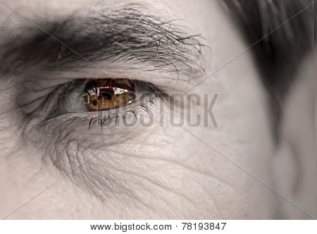 A closeup of an older man's eye. poster