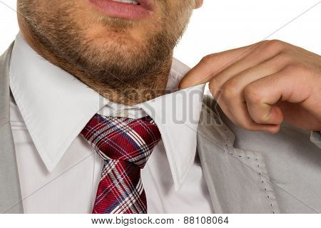 a man   feels constricted. the collar bursts.