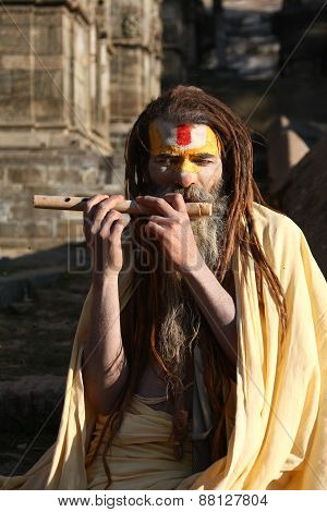 KATHMANDU, NEPAL-DECEMBER, 2009 - An unidentified ascetic or sadhu in pashupatinath temple waiting f