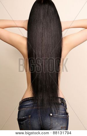 Back View Of Sexy Woman With Luxurious Dark  Hair