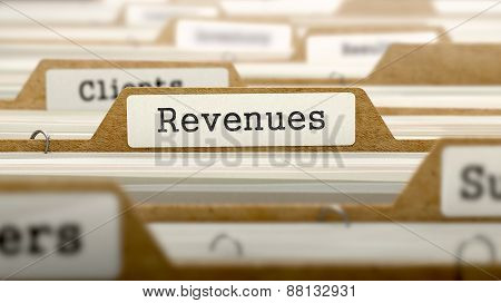 Revenues Concept with Word on Folder.