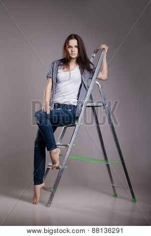 Young woman on step ladder.