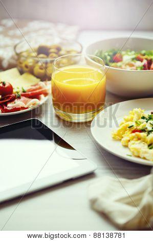 Fresh Breakfast Food. Scrambled Eggs And Juice.