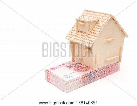 House Stands On Stack Of Rmb Paper Currency On White With Clipping Path