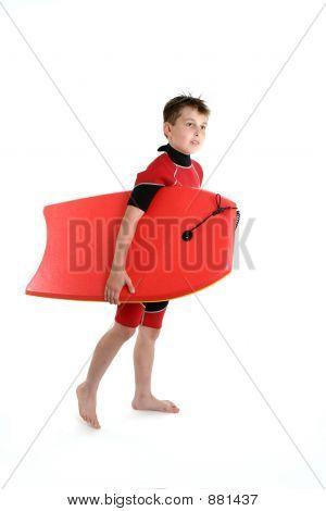 Surfer Boy Holding A Bodyboard