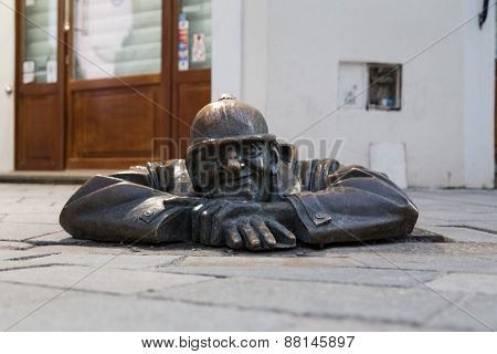 BRATISLAVA, SLOVAKIA - JANUARY 6, 2015: Cumil (The Watcher), one of the popular Bratislava street statues. It is placed at the junction of Laurinska and Panska streets.