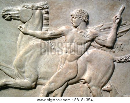 Roman marble relief of a naked youth with his horse