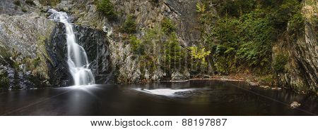 Panoramic view of a waterfall in a canyon in the High Fens Ardennes Belgium. Long exposure shot. poster