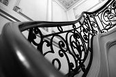 wrought iron steps in a residential mansion. poster