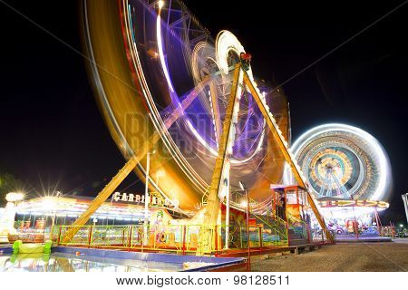 Colorful Carnival Ferris Wheel And Gondola Spinning