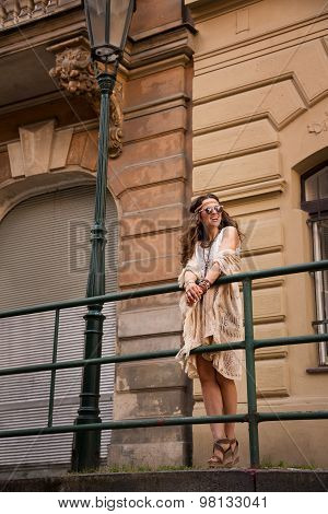 Hippie Chic With Sunglasses Near Old Town Streetlight
