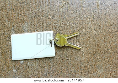 Key Card Holder On Tile Background