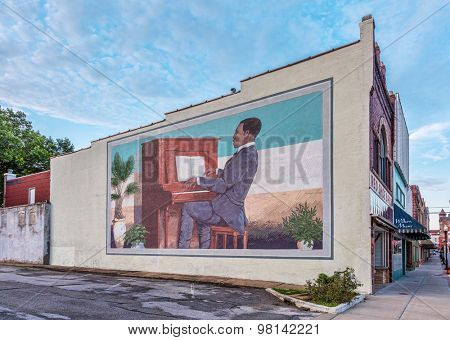 SEDALIA, MO, USA - AUGUST 3, 2015: Scott Joplin plays Maple Leaf Rag on piano - a large building wall mural by Stanley James Herd in historic downtown of Sedalia, Missouri.
