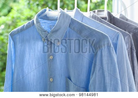 ironing housework ironed folded shirts clean concept still life garment apparel cloth indoors poster