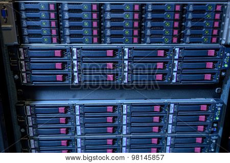 Rack of webserver harddisks in datacenter showing internet traffic