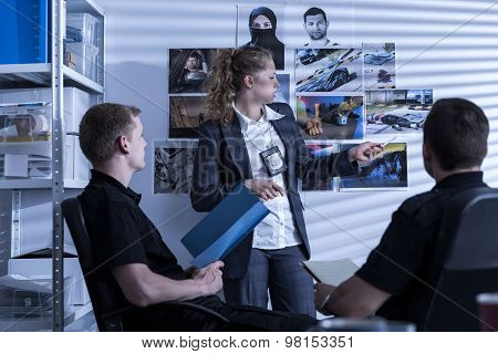 Picture of police team during investigation watching evidences poster