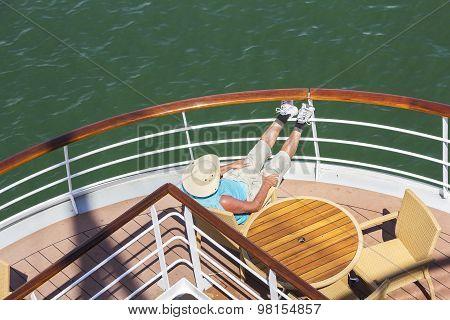 Man Enjoys The Sailing Cruise Ship