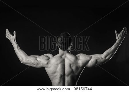 Strong, muscular guy on a black background