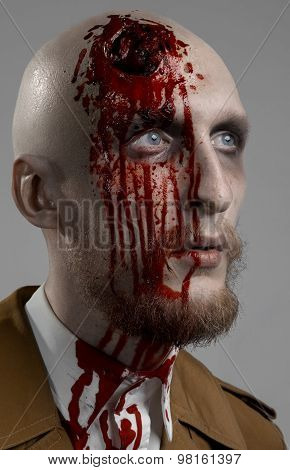 Bald Man With A Broken Head, A Bloody Man With A Beard And Mustache, A Bloody Man With A Brown Coat