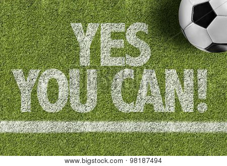 Soccer field with the text: Yes You Can!